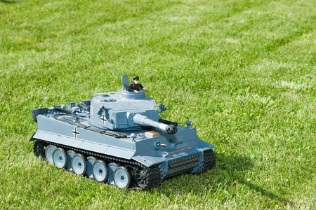 small world: German heavy tank of World War II model on a  grass