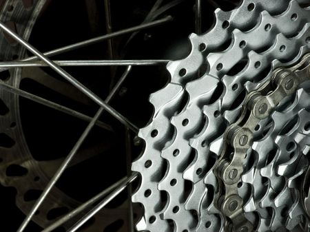 Rear mountain bike wheel detail with cassette,  chain, spokes and brakes disc rotor close-up Stock Photo - 3401907