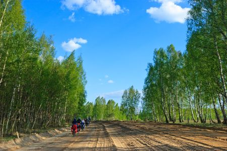 Group of Bicycle tourists on a dirt road photo