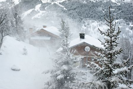 Ski resort at snow storm, Meribel, Trois Vallees, France Stock Photo - 3404521