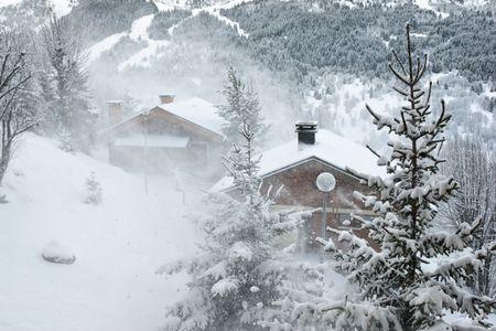Ski resort at snow storm, Meribel, Trois Vallees, France Stock Photo - 3404521
