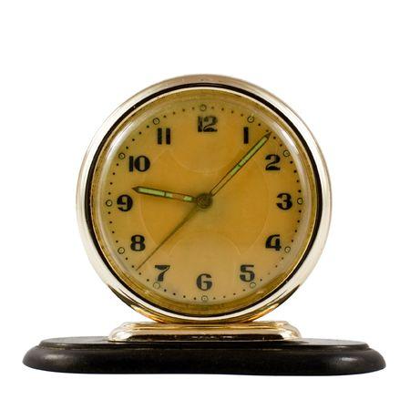 Vintage mechanical wind-up alarm clock isolated on white background photo