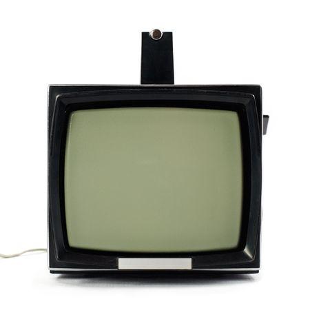 Vintage portable Television set isolated on white background photo