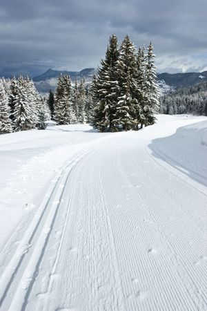 groomed: Freshly groomed empty cross-country ski track at French Alps