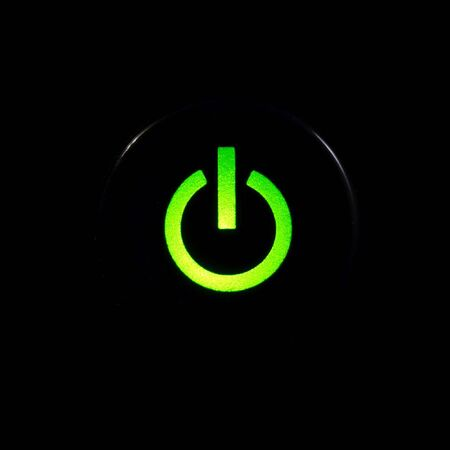 Glowing power button on black background Stock Photo - 3522154