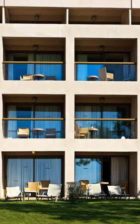 stanza: Empty balconies with chairs and tables