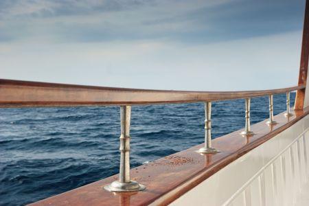 glum: Rail of Pleasure boat sailing the Aegean sea