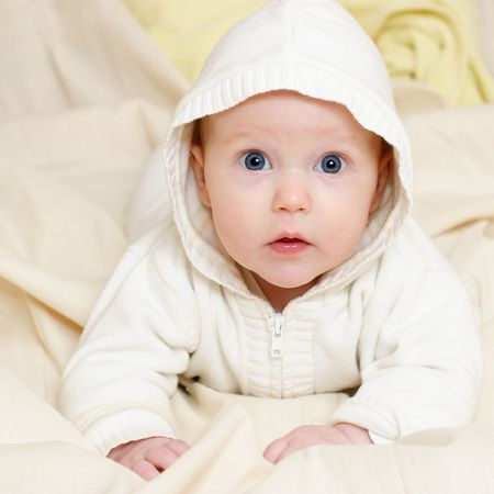 rapture: Portrait of four month baby girl wearing hood Stock Photo