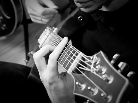 Musician playing  electric guitar, shallow depth of field Stock Photo - 3627104