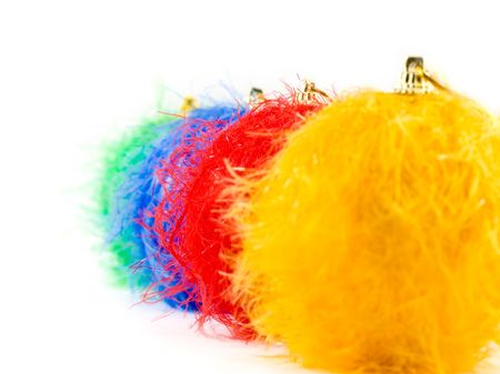 nappy new year: Fluffy christmas baubles on white background, focus on red bauble