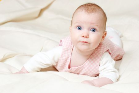 Portrait of attentive four month baby girl with blue eyes and red hair Stock Photo - 3696359