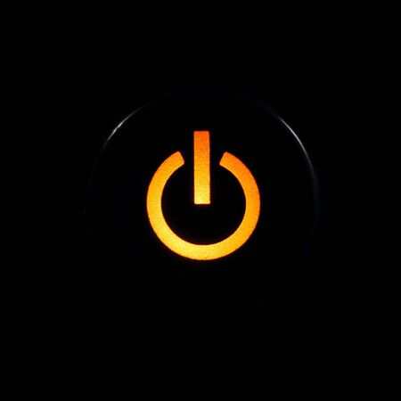 Amber glowing power button on black background Stock Photo - 3729714