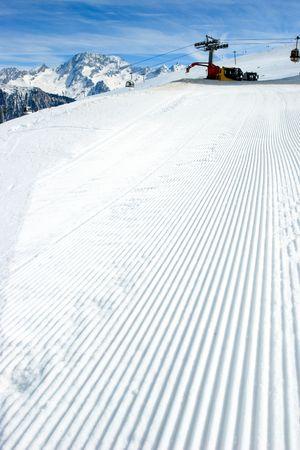 snowcat: Snowcat track close-up with Snowcat at background