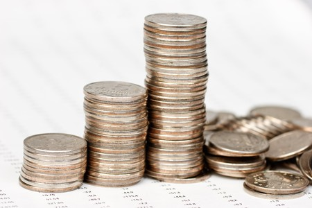 bad fortune: Growing coins chart  with collapsing final bar on financial report Stock Photo