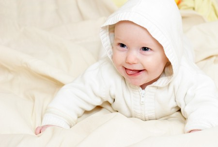 Happy four month baby girl wearing hood photo