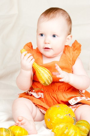 Little baby girl playing with calabash pumpkin Stock Photo - 4301137