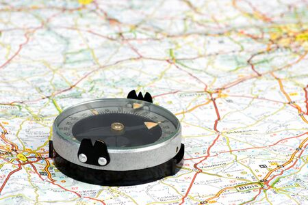 Navigation with compass and map Stock Photo - 4322322