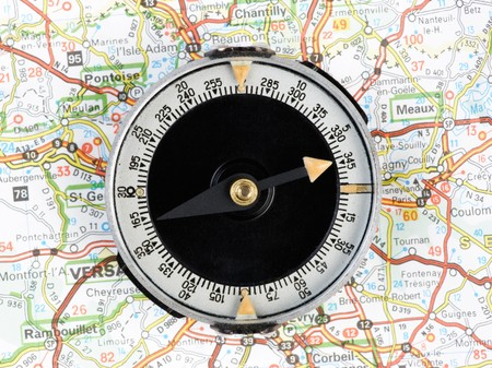 Navigation with compass and map Stock Photo - 4322324