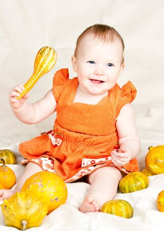 Little baby girl playing with calabash pumpkin Stock Photo - 4339380
