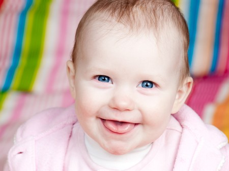 Portrait of cheerful blue-eyed baby girl Stock Photo - 4360444