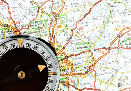 Navigation with compass and map Stock Photo - 4521584