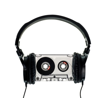 HIfi headphones on vintage Compact Cassette on white background Stock Photo - 4521587