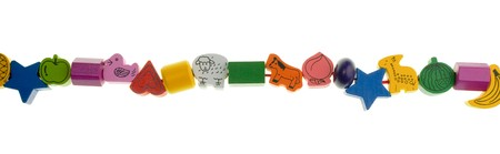 Colorful wooden toy beads on white background photo