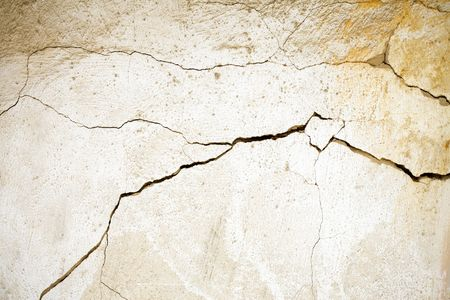 plastered: Cracked plastered wall of abandoned building Stock Photo