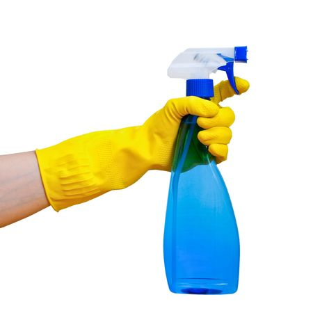 Hand in yellow protective glove holding blue transparent spray bottle on white background Stock Photo