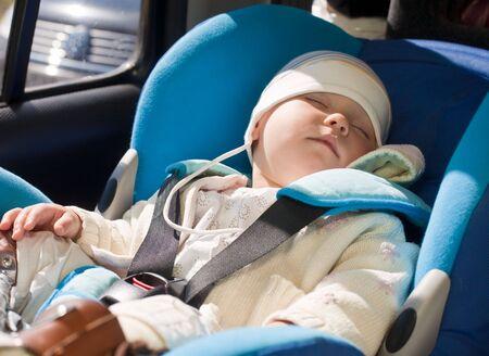 Toddler sleeping in a car seat photo