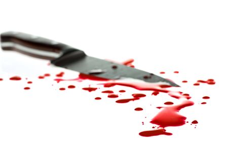 Red blood splatter with  kitchen knife in background, shallow DOF Stock Photo - 5163059