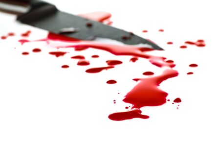Red blood splatter with  kitchen knife in background, shallow DOF Stock Photo - 5183803