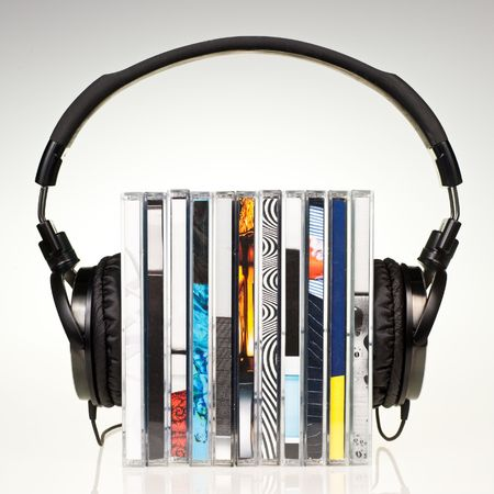 medium group of object: HI-Fi headphones on stack of CDs Stock Photo