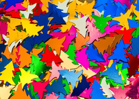 Multicolored Christmas tree shaped confetti backgroud photo