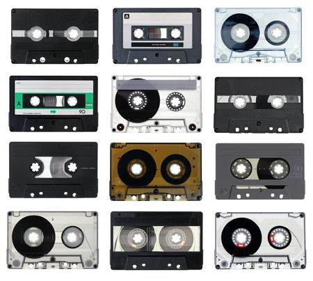 Collection of vintage Compact Cassettes on white background photo