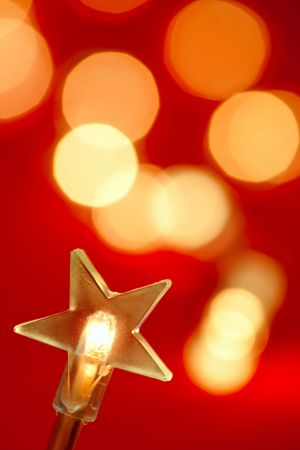 Star shaped Christmas light with blured lights in background, very shallow DOF photo