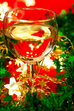 Glass of white wine with Christmas decoration, very shallow DOF photo