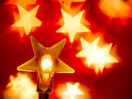 blured: Star shaped Christmas light with blured background, very shallow DOF