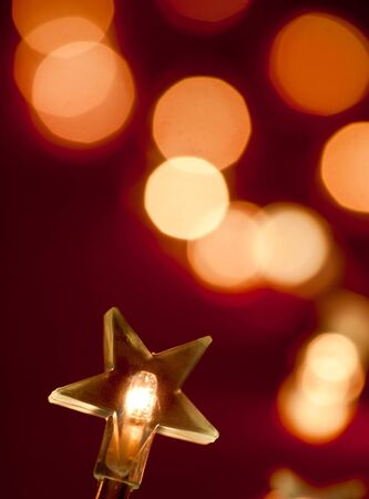 shallow dof: Star shaped Christmas light with blurred background, shallow DOF