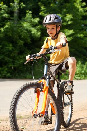 Young boy riding bicycle, shallow dof photo