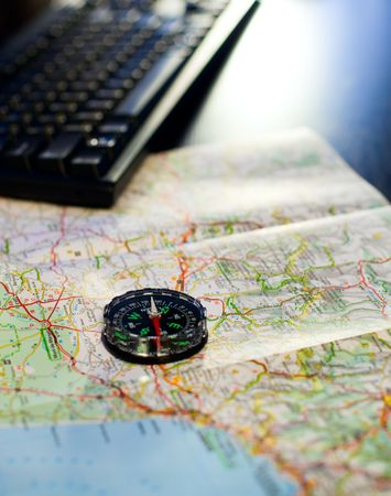 Compass and map on a table with  keyboard, very shallow DOF Stock Photo - 5826401