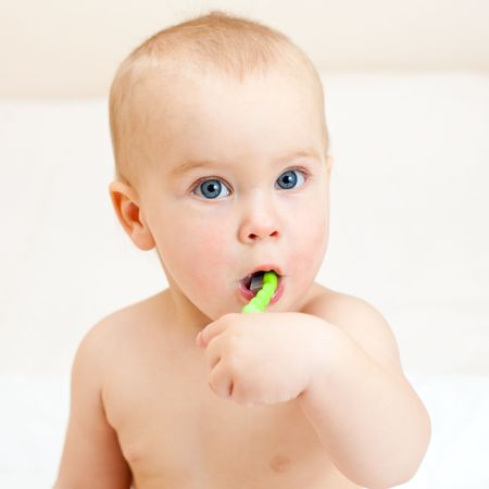 oral care: Little baby girl with green tooth brush