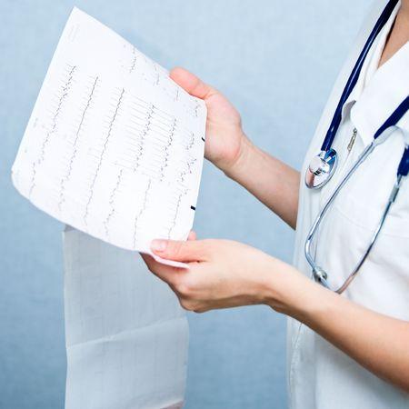 Doctor holding ECG print, shallow focus Stock Photo - 5920472