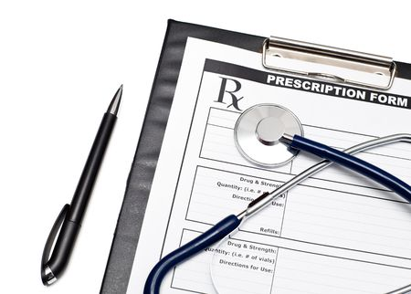 Blank prescription form on clipboard  with stethoscope and pen Stock Photo - 5920492