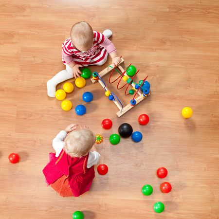 Top view of little girls playing on the floor photo