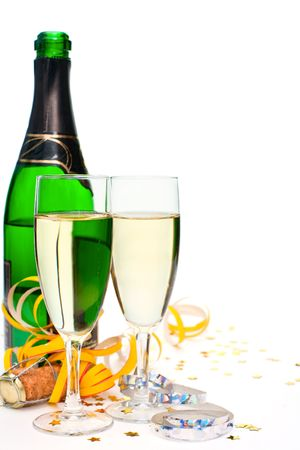 Two glasses of champagne with ribbons and confetti on white background photo