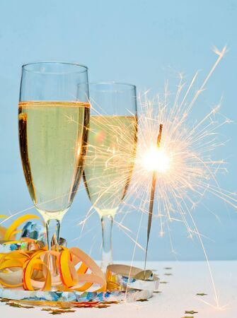 Two glasses of champagne with ribbons and burnning sparkler Stock Photo - 5990467