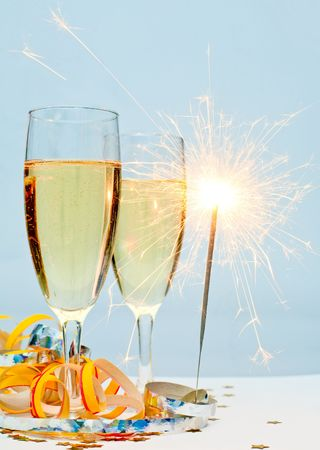 Two glasses of champagne with ribbons and burnning sparkler photo