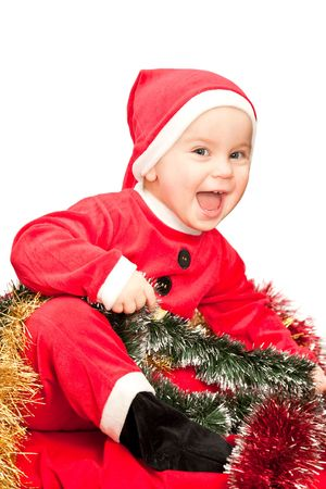 Little baby girl wearing Santa Claus costume on white background photo