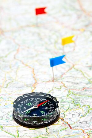 Compass on map with color flag pins Stock Photo - 6089795